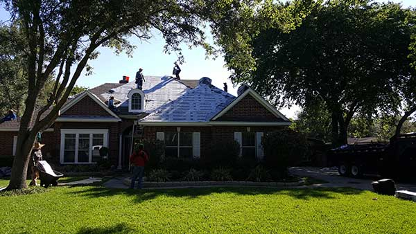 putting up a new roof in League City