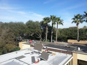 commercial roof instal under way in Oaks of Clear Creek