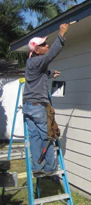 painting exterior of home in action